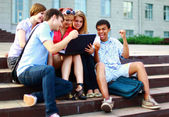 Students sitting together at school — Stock Photo
