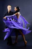 Dancers against black background — Stock Photo