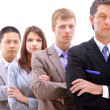 Businessman leading a business team in a line — Stock Photo