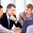 Stock Photo: Business meeting - manager discussing work with his colleagues