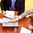 Business handshake over workplace — Stock Photo
