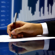 Businessman's hand with pen — Stock Photo