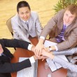 Businessteam and hands on top of each other — Stock Photo #4304995