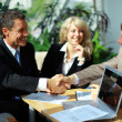 Business shaking hands, finishing up a meeting - Stock Photo