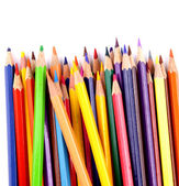 Close up of color pencils with different color over white background — Stock Photo