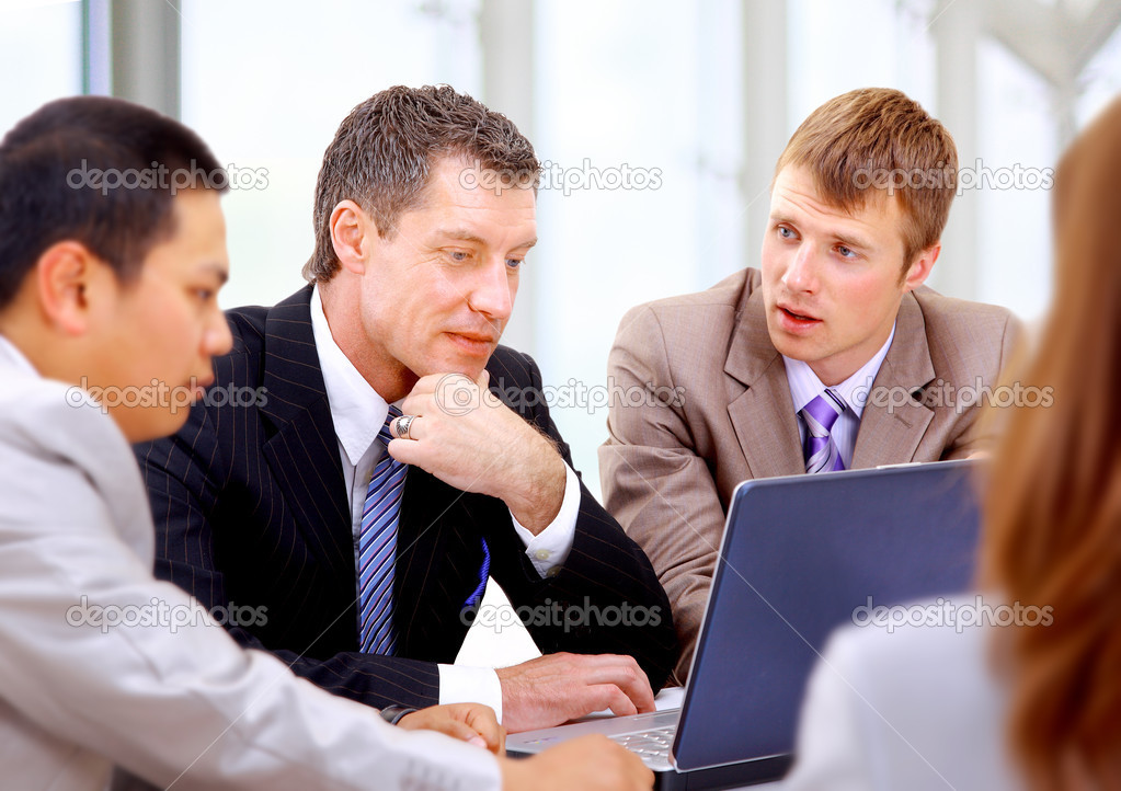 Business meeting -  manager discussing work with his colleagues  Stock Photo #4304770