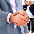 Handshake isolated on business background - Stock Photo
