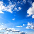 Blue sky background with tiny clouds - Stockfoto