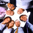 Group of business standing in huddle — Stock Photo #4335825