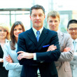 Stock Photo: Confident mature business man with colleagues at the background
