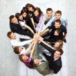 Top view of business with their hands together in a circle — Stock Photo #4336035
