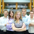 Businesswoman in a office and his team - Stock Photo