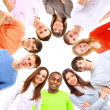 Low angle view of happy men and women standing together in a circle — Stock Photo
