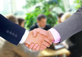 Handshake isolated in office — Stock Photo
