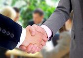 Handshake isolated in office — Stock Photo