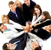 Bovenaanzicht van het bedrijfsleven met hun handen samen in een cirkel — Stockfoto