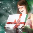 Beautifull girl opening x-mass magic present. Christmas — Stock Photo #4462014