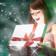 Beautifull girl opening x-mass magic present. Christmas - Stock Photo