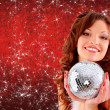Picture of sexy santa helper with disco ball — Stockfoto