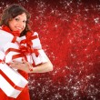 Portrait of a beautiful young woman wearing christmas clothes over sky of s — Stock Photo