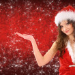 Woman dressed as santa with her hand up, place your product here — Stock Photo