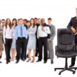 Contemporary office chair and businessman - Stock Photo