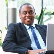 Portrait of a handsome young business man with a laptop — Stock Photo #4463007