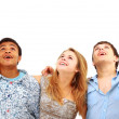 Closeup portrait of many men and women smiling and looking upwards against — Stock Photo #4463350