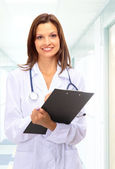 Beautiful young doctor with stethoscope — Stock Photo