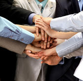Hands piled on top of one another. — Stock Photo