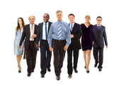 Happy young businessmen standing in front of her team — Stock Photo