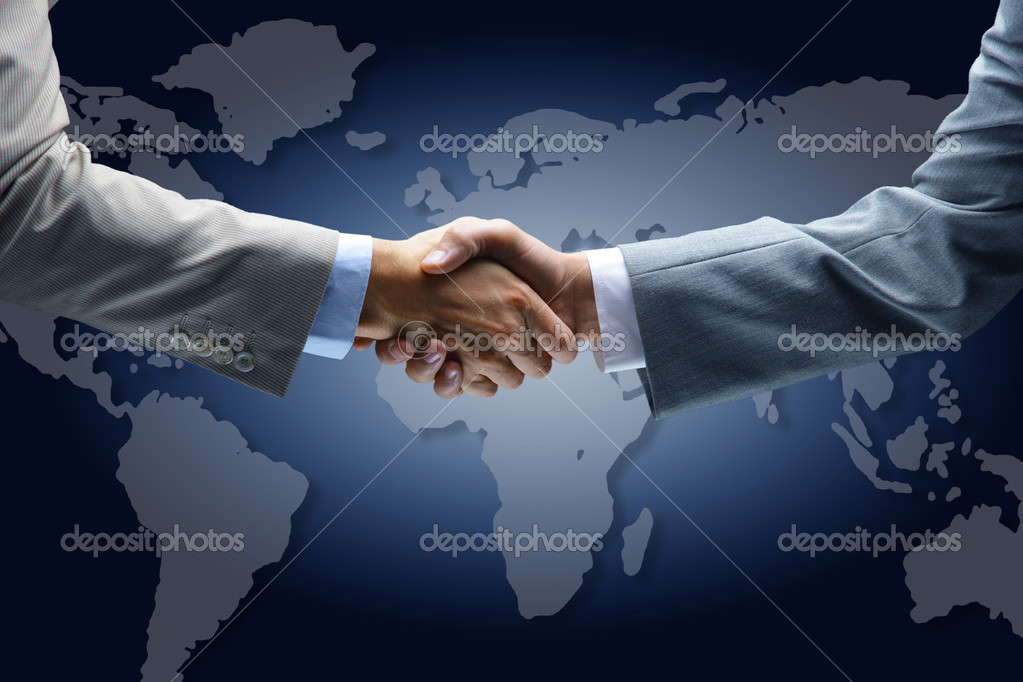 Handshake with map of the world in background  — Stock Photo #4462420