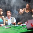 Group of sinister poker players — Stock Photo #4528292