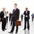 Royalty-Free Stock Photo: Business man and his team isolated over a white background