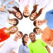Low angle view of happy men and women standing together in a circle — Stock Photo #4528874