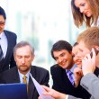 Business discussing the growth of income at a table in the office — ストック写真