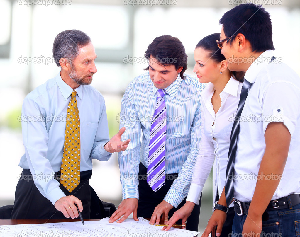 Business meeting - manager discussing work with his colleagues  — Stock Photo #4589743