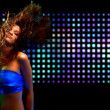 Foto Stock: Beautiful young womdancing in nightclub