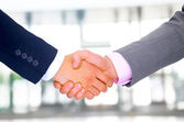 Business men hand shake in the office — Stock Photo