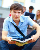 Young man read book — Stock Photo