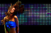 Beautiful young woman dancing in the nightclub — Stok fotoğraf
