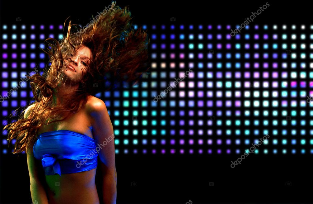Beautiful young woman dancing in the nightclub  — Stock Photo #4659562