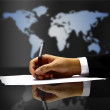 Businessman's hand with pen — Stock Photo #4660130