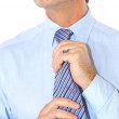 Portrait of a businessman fixing necktie — Stock Photo #4668488