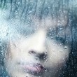 Royalty-Free Stock Photo: Sad young woman and a rain drops
