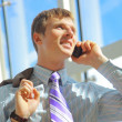 Young happy businessman calling on mobile phone, outdoor, smiling — Stock Photo #4668606