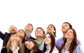 Closeup portrait of many men and women smiling and looking upwards — Stock Photo