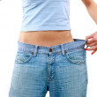 Happy young woman in old jeans pant after losing weight — Stock Photo #4673279