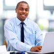 Portrait of a handsome young business man with a laptop - 