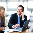 Business man speaking on the phone while in a meeting — Stockfoto #4813795